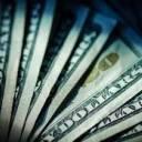 За хабар в сумі 1000 доларів чиновниця постане перед судом